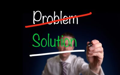 A business man writing, Problem Solution diagram on a clear screen.